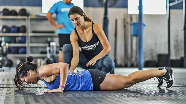 Anybody can push you through a workout, but a good coach will teach principles, not just methods. [Photo courtesy CrossFit Empirical]